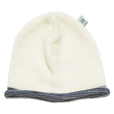 Flatlay of a pure wool Branberry beanie in ivory white with contrast navy blue marl roll edge