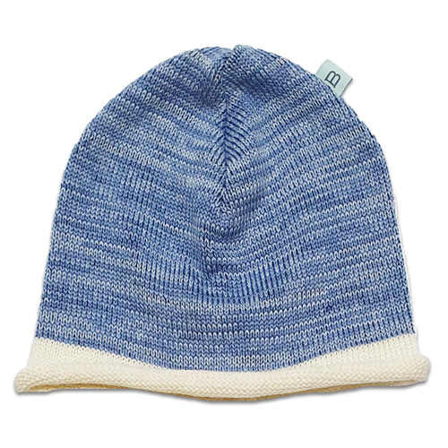 Flatlay Roll edge Pure wool Branberry beanie in azure blue marl