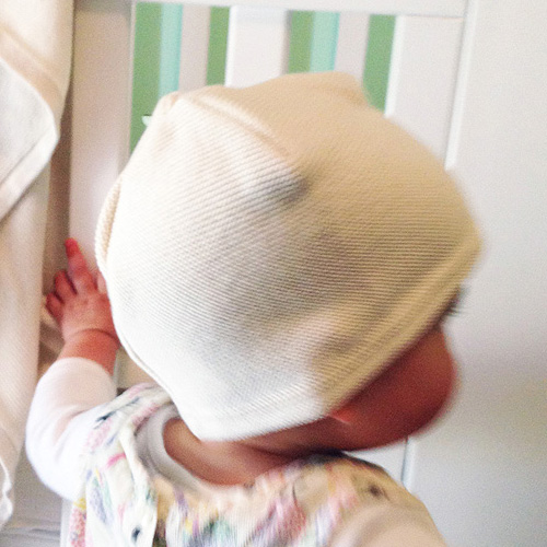 Tiny Garter Beanie in Ivory White on a Toddler
