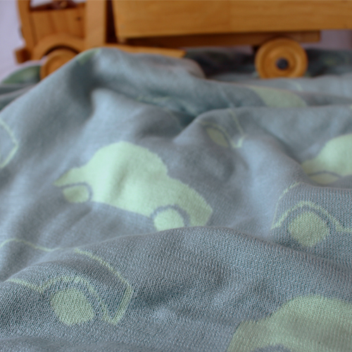 australian made Branberry knitted pure cotton blanket design with cars repeated all over in blue and mint green