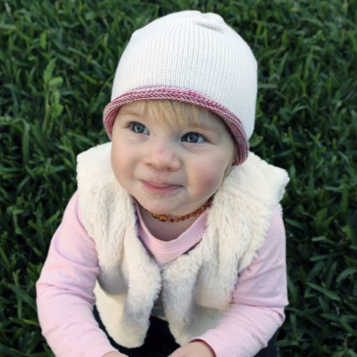 Toddler girl wearing a white and pink marl affinity branberry beanie