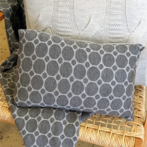 Pure Australian Merino Wool knitted Branberry Cushion in a spot and dot design in grey tones