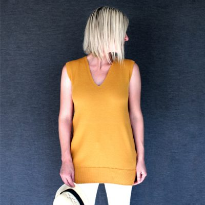Women wearing a Branberry Australian Made, merino wool knitted singlet in a copper colour