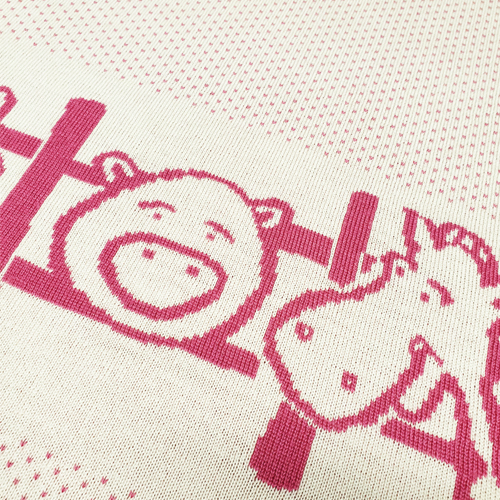 Australian made knitted merino wool Farm animals blanket in pink. Close up of a horse and pig peeking through the fence.