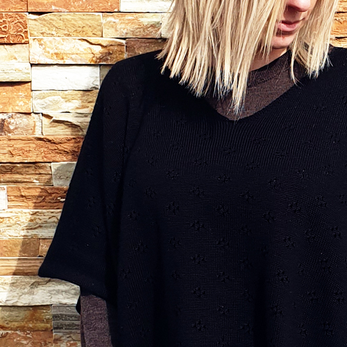 close up up the upper body of a lady wearing a branberry Pure Merino Wool Poncho in Black