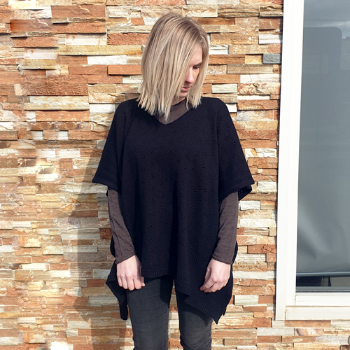 lady standing wearing a branberry Pure Merino Wool Poncho in Black