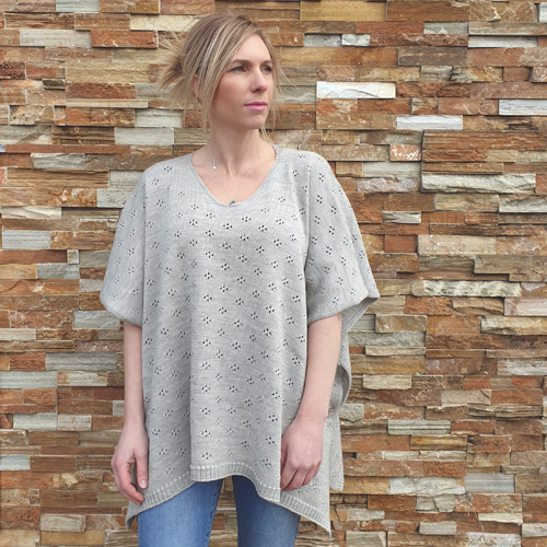 lady standing wearing a branberry Pure Merino Wool Poncho in smoke