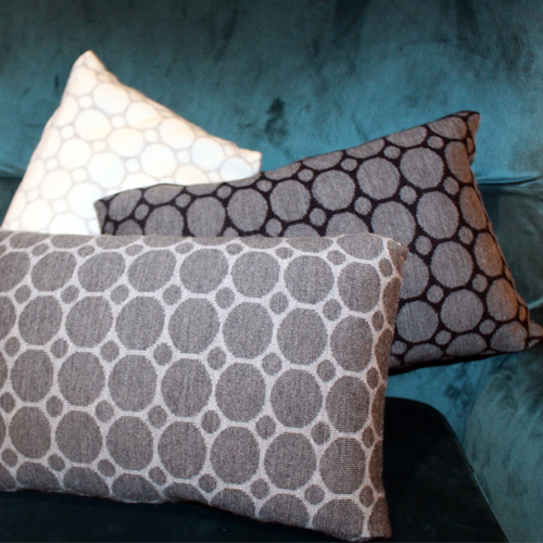 Pure Australian Merino Wool knitted Branberry Cushions in a spot and dot design. Navy, Grey and White cushions are all throw together