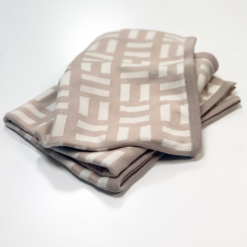 Australian made pure cotton Bricks designed Branberry blanket in Beige and White, folded.