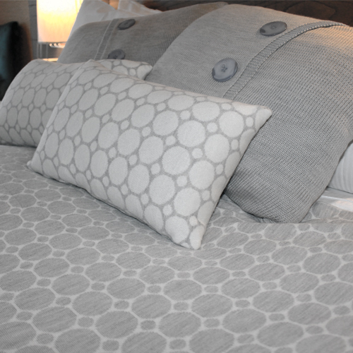 Pure Australian Merino Wool knitted Branberry Cushions in a spot and dot design. in Silver Grey and White