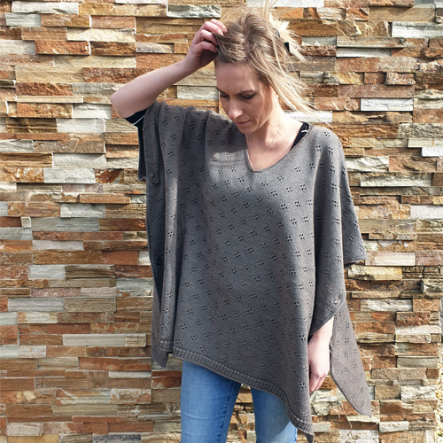 lady standing wearing a branberry Pure Merino Wool Poncho in coral
