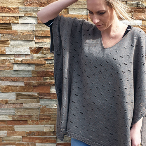lady standing wearing a branberry Pure Merino Wool Poncho in moccha brown