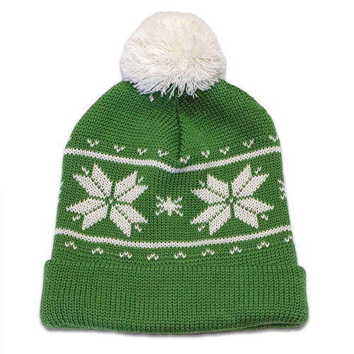 Flatlay of an Australian Made, Australian Merino Wool Snowflake Beanie in Apple Green and White with a pom pom