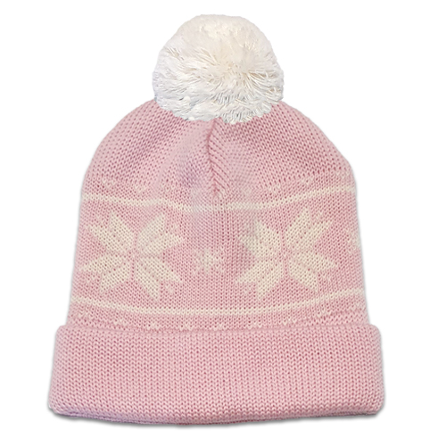 Flatlay of an Australian Made, Australian Merino Wool Snowflake Beanie in Pale Pink and White with a pom pom