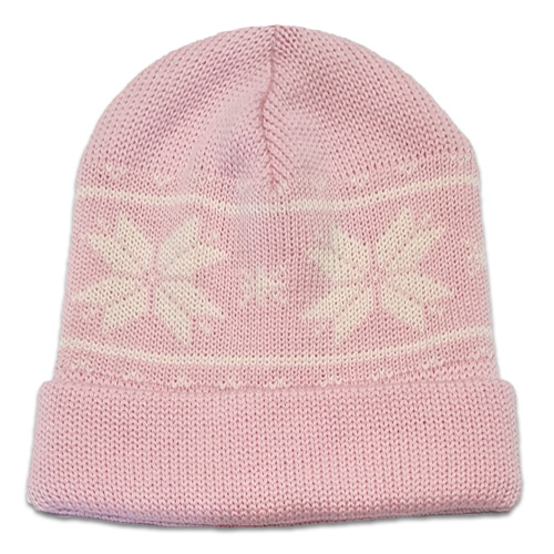 Flatlay of an Australian Made, Australian Merino Wool Snowflake Beanie in Pale Pink and White