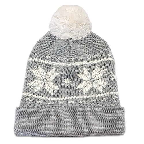 Flatlay of an Australian Made, Australian Merino Wool Snowflake Beanie in Silver and White with a pom pom