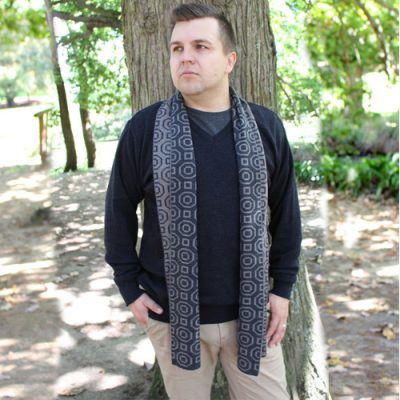 Man wearing an Australian Made, Branberry Pure Merino Wool Art Deco Scarf in Grey & Moccha