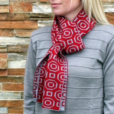 Lady wearing an Australian Made, Branberry Pure Merino Wool Art Deco Scarf in Red & Silver