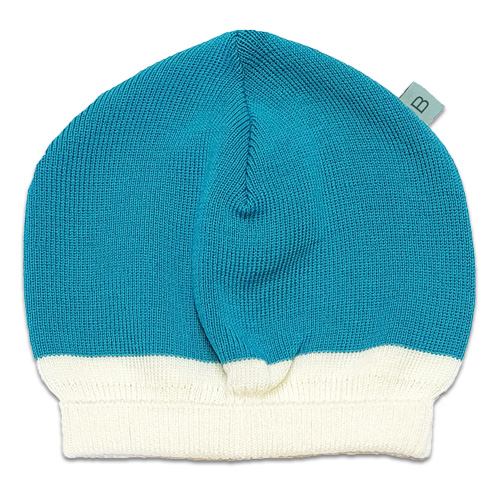 Flatlay of an Australian Made, Australian Merino Wool Zest Contrast Beanie in Aqua and White