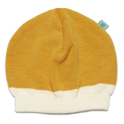 Flatlay of an Australian Made, Australian Merino Wool Zest Contrast Beanie in Mango, (Bright Yellow) and White
