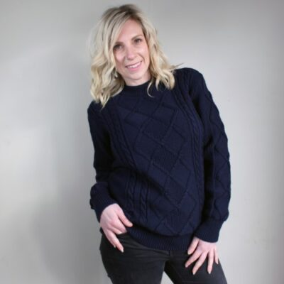 Lady wearing an Avery Aran Pure Wool Ladies Jumper in Navy